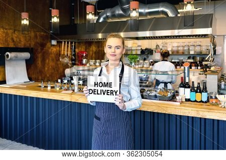 Small Business And To Go Service Concept Due To Isolation Emergency With Young Restaurant Owner Work