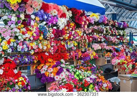 Large Selection Of Artificial Flowers And Bouquets In The Market.