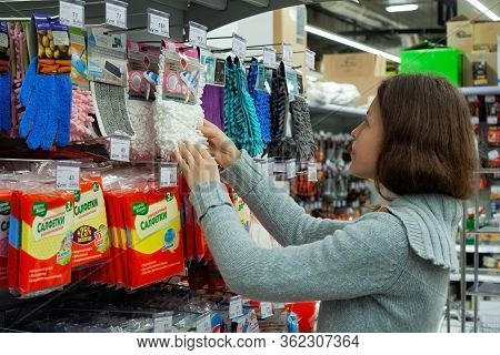 Minsk, Belarus - January 29, 2020: Housewife Chooses Products For Cleaning Home. Sponges For Dishes,