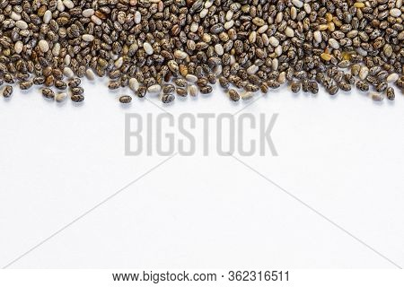 Chia Seeds Close-up Background Macro. The Texture Of The Chia Seeds. Copy Space. Flat Lay. Chia Seed