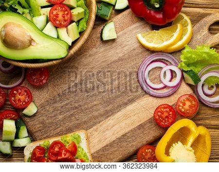 Fresh Colorful Vegetables And Healthy Cooking Ingredients Around Empty Wooden Cutting Board, Rustic