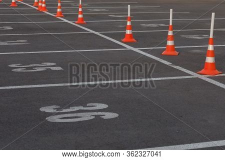 Car Parking Lot With White Mark And Traffic Cone On Street Used Warning Sign On Road. Traffic Cones