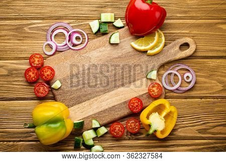 Fresh Colorful Vegetables And Healthy Cooking Ingredients Around Empty Cutting Board, Wooden Rustic