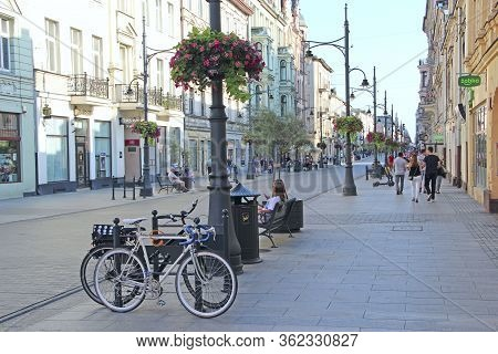 Lodz / Poland. 18 July 2019: View Of City Street With Many Bicycles. Bicycles Parked Near Lantern In
