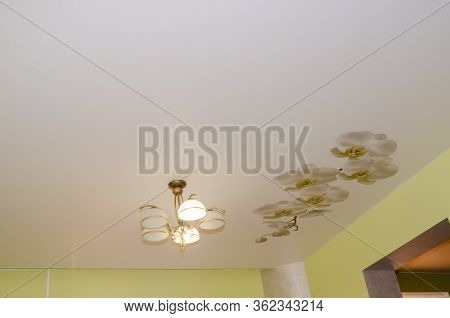 Beautiful Stretch Ceiling With Vintage Chandeliers And An Orchid Flower