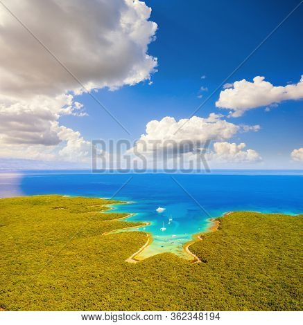 Exotic aerial view of the azure lagoon on sunny day. Location Kvarner Gulf, Punta Kriza, Cres island, Croatia, Europe. Drone photography of popular tourist attraction. Discover the beauty of earth.
