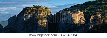 Monastery of Varlaam monastery and Great Meteoron Monastery in famous greek tourist destination Meteora in Greece on sunrise