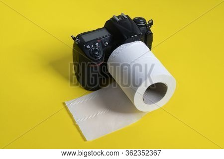 An Slr Camera With A Roll Of Toilet Paper As A Lens