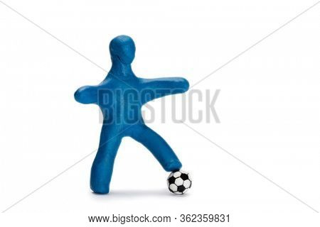 Plasticine small person soccer player with a ball isolated on white
