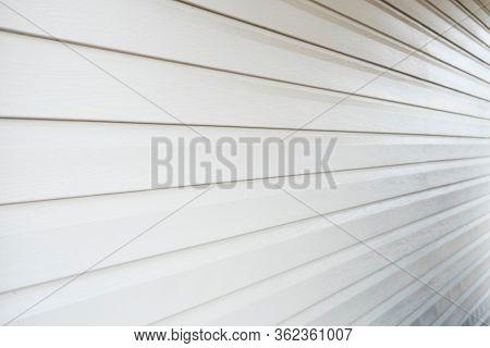 Light vinyl siding as background
