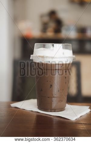 Delicious Cold Refreshing Coffee Mocha Mix Dark Chocolate Topping With Milk Froth On Wood Table