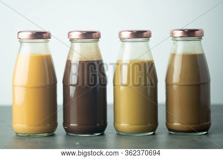 Various Of Cold Coffee, Cold Thai Milk Tea And Cold Cocoa In Retro Glass Bottles