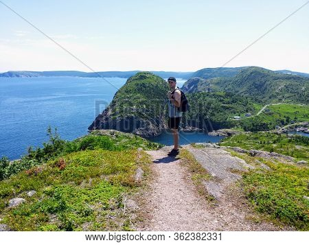 A Man Posing For A Photo With Beautiful Views Hiking The East Coast Trail Off The Coast Of Newfoundl