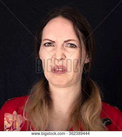 Emotion. Closed Woman Face With Facial Expressions Over Black Background