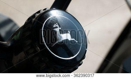 Nagybajcs Hungary 04 04 2020: John Deere Tractor Company Logo On A Tractor Handlebar.
