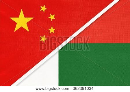 China Or Prc Vs Madagascar National Flag From Textile. Relationship Between Asian And African Countr