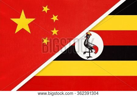 China Or Prc Vs Uganda National Flag From Textile. Relationship Between Asian And African Countries.