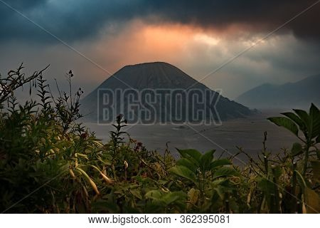 The Scenery Of Mount Batok In A Hazy Look In Sunset Time At Java Island, Indonesia.
