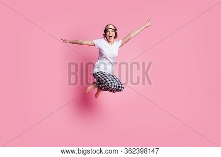 Full Size Photo Of Funny Lady Jump High Up Rejoicing Slumber Party Spread Hands Sides Wear Sleep Mas