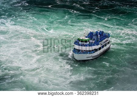 Ship With Tourists Moves To Niagara Falls, Falls Boat Tour Experience Is North America Oldest Attrac
