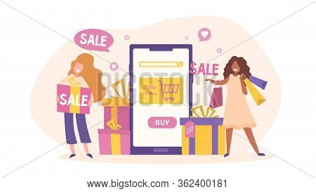 Online Shopping Or Sale Concept With Two Happy Woman Carrying Sale Merchandise Flanking A Tablet Or