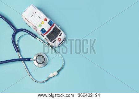 Ambulance Car And Stethoscope And On A Blue Background. Concept Calling Doctor To Home Check Up