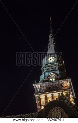 Close Up On The Clock Tower Of The Subotica City Hall, In Serbia, At Night, Lit. Also Called Gradska