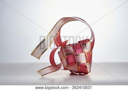 close up ribbon ketupat on white background