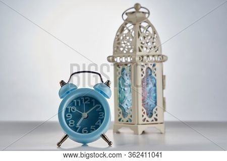break fasting -alarm clock with the islamic design lantern on white background