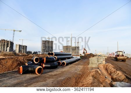 Laying Of Underground Storm Sewer Pipes At The Construction Site.. Installation Of Water Main And Sa