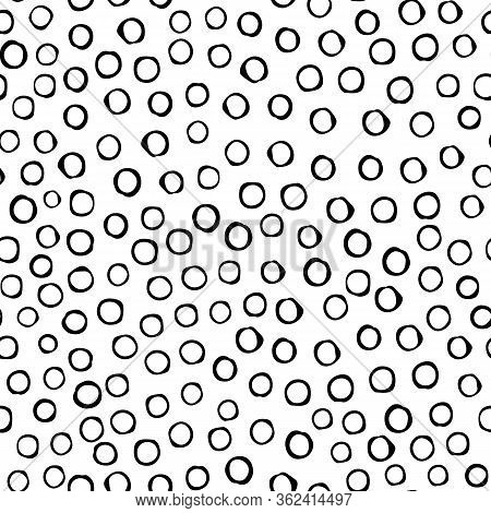 Black circles are arranged in random order with a void inside on an isolated background. Vecton illustration. Stock illustration. You can use the pattern on wrapping paper or fabric.