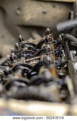 The Engine Compartment Of A Car Close-up. Engine Timing. Detailed Shot Of A Carburetor Engine Withou