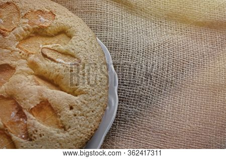 Tasty Pie With Quince Slices. Homemade Sweet Quince Pie. Traditional Round Pie On Burlap. Baking Wit