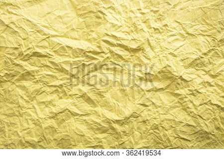 Yellow Crumpled Paper Background. Twisted Yellow Paper. Seamless Pattern.