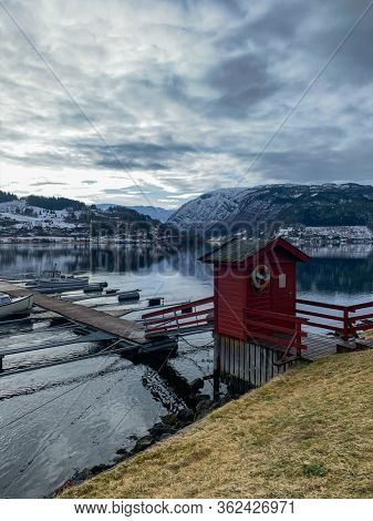 Boats near pier in Hardangerfjord in Norway