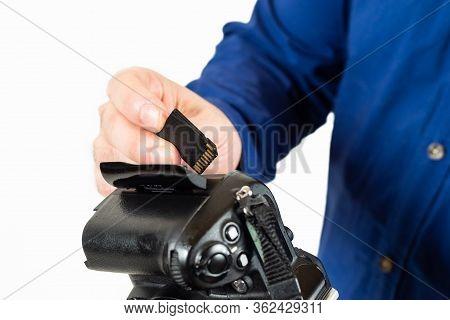 Man Inserting A Memory Card In A Reflex Camera