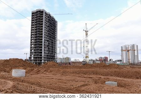 Tower Cranes Constructing New Residential Buildings At Construction Site. Installation Of Concrete S