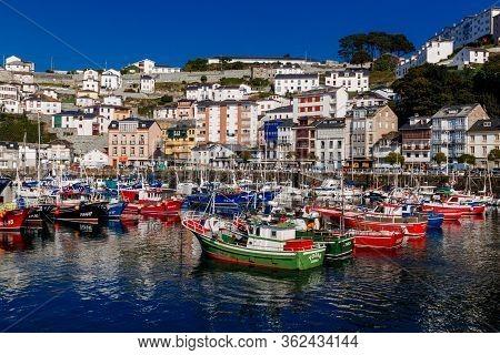 Luarca, Spain  - 06 October 2016: Colorful Fishing Boats In Luarca, Asturias, Spain.