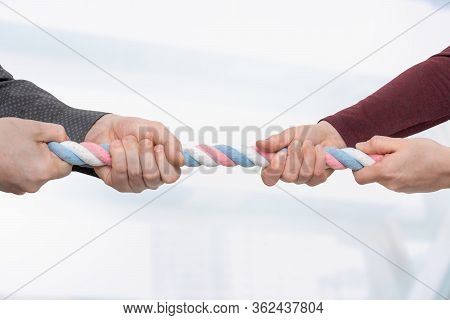 Business People Pulling Rope In Opposite Directions - Rivalry Concept