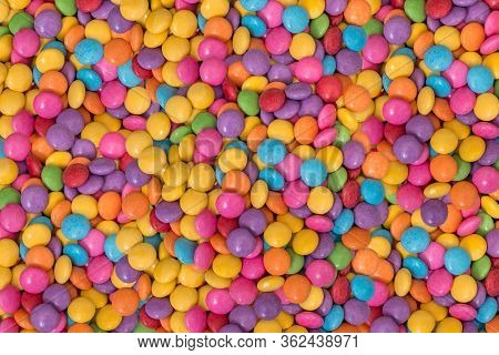 Pile Of Color Chocolate Candies - Smarties Background