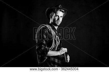 Adventure Lover. Vintage Style Man. Wild West Retro Cowboy. Wild West Rodeo. Man In Hat Black Backgr