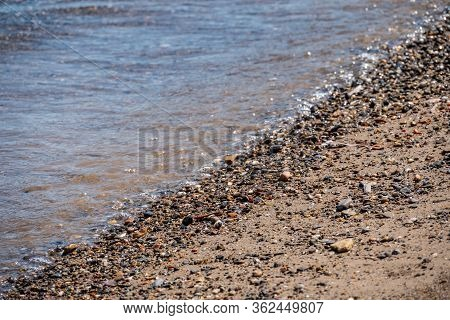Soft Wave Of Blue Sea On Sandy Beach. Background - Summertime Concept.