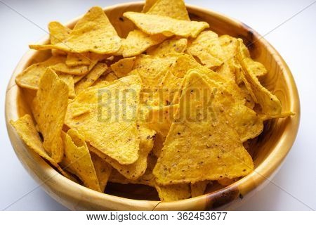 A Bowl Of Corn Chips Nachos Close-up On A White Background. Mexican Chips Appetizer
