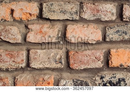 Part Of A Stone Wall, For Background Or Texture. Vintage Stone Wall.
