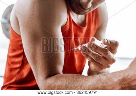 Cropped View Of Bearded Sportsman Making Doping Injection
