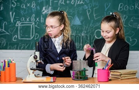 Chemistry Research In Laboratory. Little Girls Genius In School Lab. Science Lab. Science Experiment