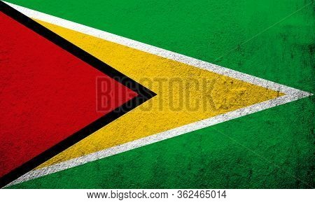 The Co-operative Republic Of Guyana National Flag The Golden Arrowhead. Grunge Background