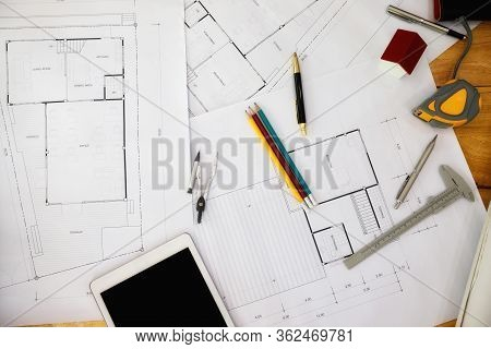 Construction Blueprints With Tools And Tablet, Top View. Tablet With Architectural Blueprints And Me