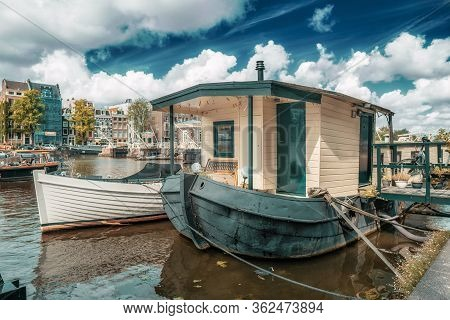 Lovely Houseboat On A Lake In A Blue Sky Environment