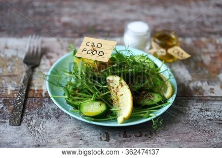 The Inscription Cbd Food In A Salad. Spring Salad With Microgreens, Lemon And Cucumber With Seeds An